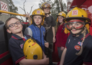 Children from Arthur's Creek Primary School wearing CFA helmets