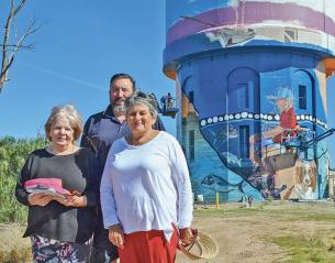 Port Vincent Water Tower, with people standing in front of it